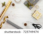 gift box wrapped in black and... | Shutterstock . vector #725749474