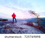 the figure of the men in red... | Shutterstock . vector #725769898