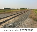 Empty Railway Track Stretching Off to Horizon - stock photo