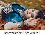 beautiful girl on maple leaves   Shutterstock . vector #725780758