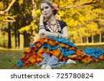 dancer sitting on the grass   Shutterstock . vector #725780824