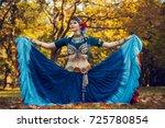 tribal dancer in a blue dress   Shutterstock . vector #725780854