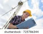 woman builder with clipboard... | Shutterstock . vector #725786344