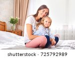 portrait of mother and daughter ... | Shutterstock . vector #725792989