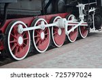 wheels of the old black steam... | Shutterstock . vector #725797024