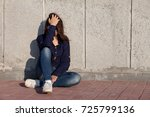 a teenage girl with depression... | Shutterstock . vector #725799136