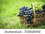 Basket With Grapes On Green...