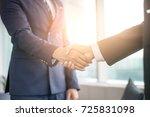 usiness people shaking hands ... | Shutterstock . vector #725831098