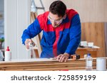 yooung repairman carpenter... | Shutterstock . vector #725859199
