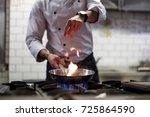 a man cooks cooking deep fryers ... | Shutterstock . vector #725864590