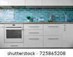 modern white kitchen a... | Shutterstock . vector #725865208