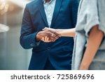 business people shaking hands... | Shutterstock . vector #725869696