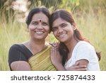 portrait of happy mother and... | Shutterstock . vector #725874433
