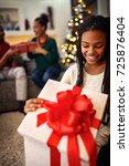 smiling african female opens... | Shutterstock . vector #725876404