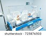 infant in incubator machine... | Shutterstock . vector #725876503