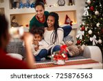 happy family at home taking... | Shutterstock . vector #725876563