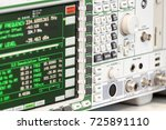 Small photo of Fragment of a modern digital oscilloscope. Scientific measuring equipment. Abstract industrial background.