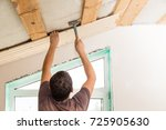 worker working on a wooden... | Shutterstock . vector #725905630