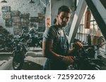 young handsome mechanic working ... | Shutterstock . vector #725920726
