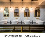 sinks mirrors and lamps in... | Shutterstock . vector #725933179