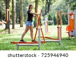woman exercising at outdoors... | Shutterstock . vector #725946940