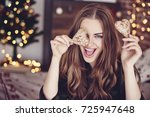 crazy woman holding cookies in... | Shutterstock . vector #725947648