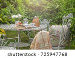cozy tea party at garden with... | Shutterstock . vector #725947768