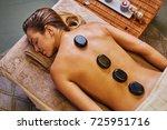 beautiful young woman relaxing... | Shutterstock . vector #725951716