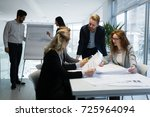 group of architects working... | Shutterstock . vector #725964094