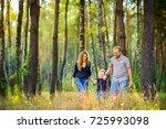 happy family walking in...   Shutterstock . vector #725993098