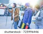 happy friends going to ski in... | Shutterstock . vector #725996446