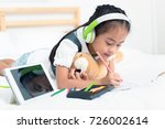 asian little girl listen to... | Shutterstock . vector #726002614
