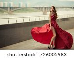 beautiful woman in red... | Shutterstock . vector #726005983