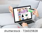 woman using laptop and credit... | Shutterstock . vector #726025828