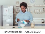 smiling african woman standing... | Shutterstock . vector #726031120