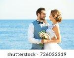 happy wedding couple on sea...   Shutterstock . vector #726033319
