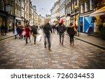 shoppers walking down busy... | Shutterstock . vector #726034453