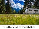 Family vacation travel, holiday trip in motorhome, Caravan car Vacation. Beautiful Nature Italy natural landscape Alps. - stock photo