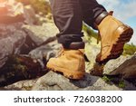 hiking boots on the rock in the ... | Shutterstock . vector #726038200