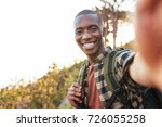 smiling young african man in a... | Shutterstock . vector #726055258