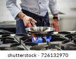 frying pan on a gas stove. chef ... | Shutterstock . vector #726132970