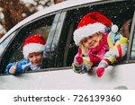 christmas car travel  happy... | Shutterstock . vector #726139360