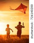 children launch a kite in the... | Shutterstock . vector #726140200