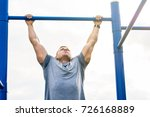masculine man doing pull ups on ... | Shutterstock . vector #726168889