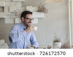 handsome young man drinking... | Shutterstock . vector #726172570