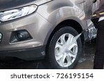 car washing at the car wash...   Shutterstock . vector #726195154