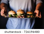 person serving four burgers in... | Shutterstock . vector #726196480