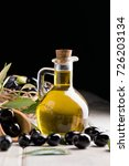olives and olive oil in a bottle   Shutterstock . vector #726203134