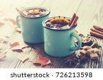 mulled wine in blue enameled... | Shutterstock . vector #726213598