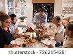 family celebrating christmas.... | Shutterstock . vector #726215428